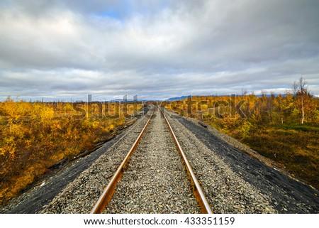 Railway track. Late autumn in the Arctic tundra. - stock photo
