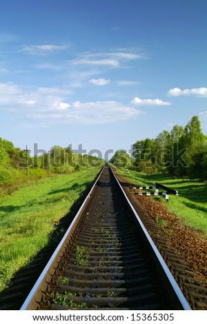 Railway track leading far onward - stock photo