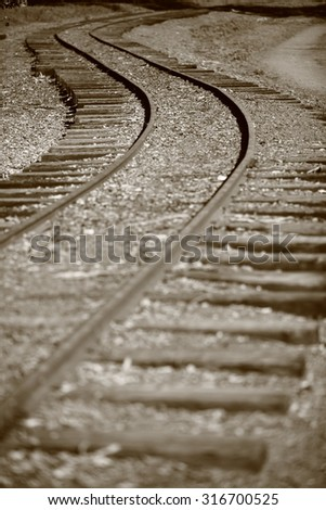 Railway track leading into the unknown - stock photo