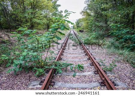railway track near Chernobyl Nuclear Power Plant in Zone of Alienation, Ukraine - stock photo