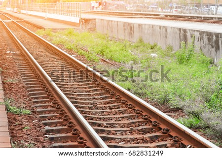 railway track old transportation train station with sunset light tone Select focus with shallow depth of field