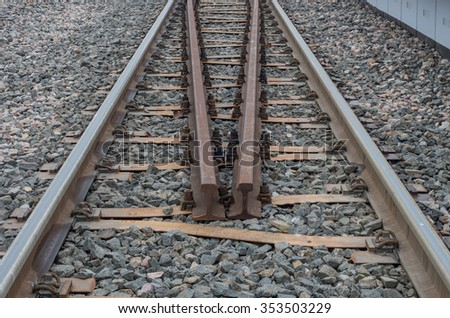 Railway track on gravel embankment, with ypsilon steel railway ties
