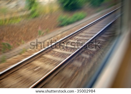 Railway track seen from the train window - stock photo