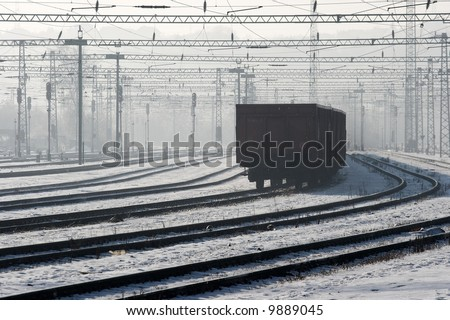 Railway track system in winter covered with snow - stock photo