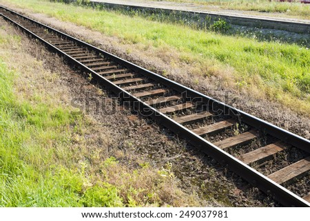 railway track with wooden sleepers - stock photo