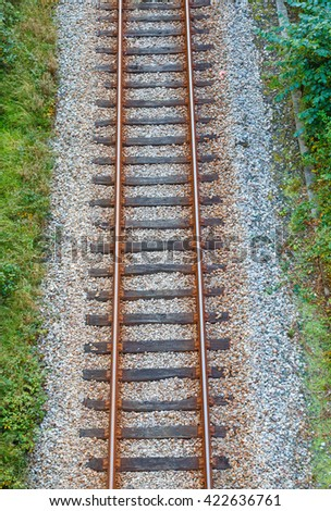 Railway track with wooden sleepers seen from above - stock photo