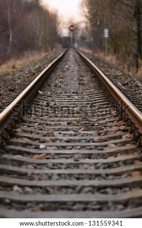 Railway tracks and gravel leading into the infinite distance - stock photo