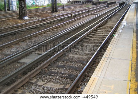 Railway tracks and platform - stock photo