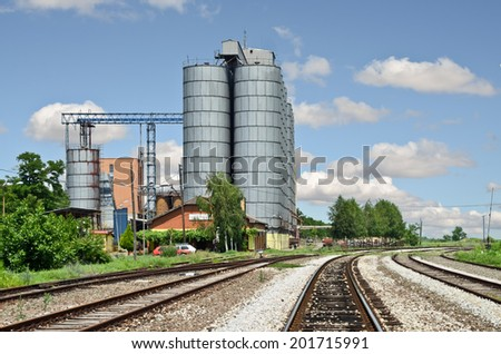 Railway Tracks and Silo - stock photo