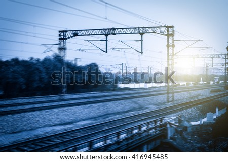 Railway Tracks at a Major Train Station at Sunset. - stock photo