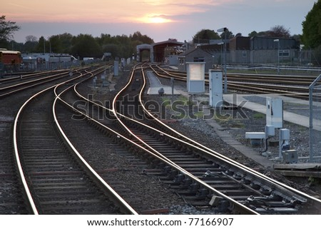 Railway Tracks at Dusk in Urban Setting - stock photo