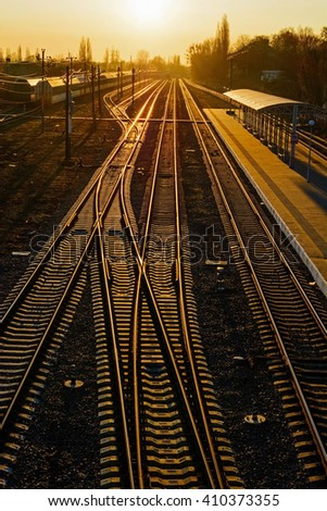 Railway Tracks at the train station at sunset. high angle - stock photo