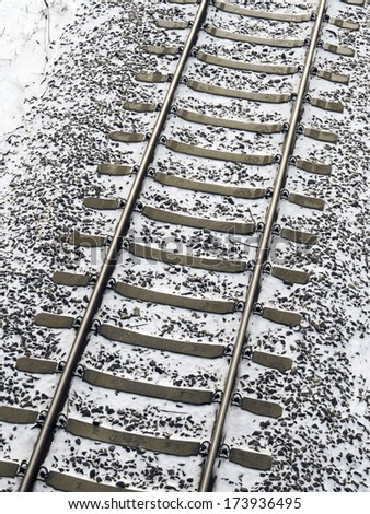 railway tracks fragment covered by fresh snow
