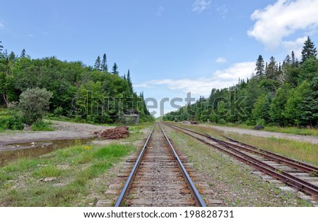 Railway tracks in a rural scene of northern Ontario, Canada - stock photo