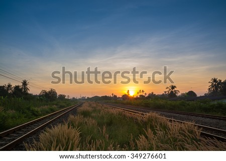 Railway tracks in a Rural Scene with Nice Sunrise - stock photo