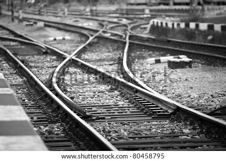 Railway tracks in front of the station, Prague. High contrast, black and white image - stock photo