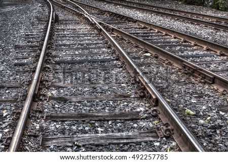 Railway tracks joining into one.
