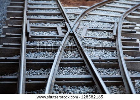 Railway tracks made �¢??�¢??of steel that is placed on a piece of wood. The stone floor was small. - stock photo