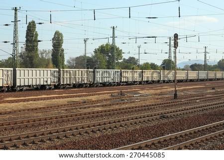 Railway tracks with freight train - stock photo