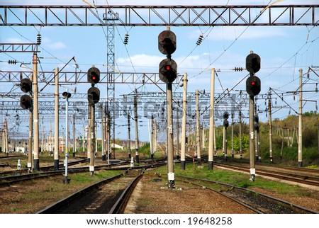 Railway traffic lights show a stop signal . - stock photo