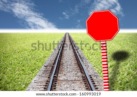 Railway traffic on the lawn and red Traffic signs. - stock photo