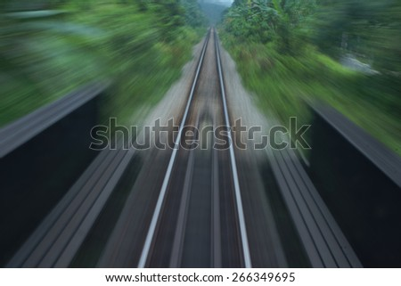 Railway trail from the moving train with the green back ground                                - stock photo
