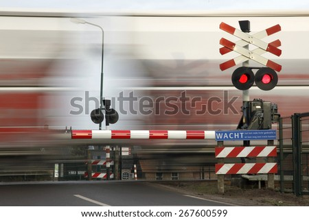 railway transport passing railroad crossing in the netherlands - stock photo