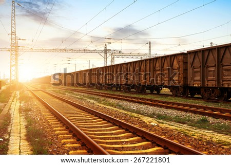 Railway truck parked at the station waiting for unloading - stock photo