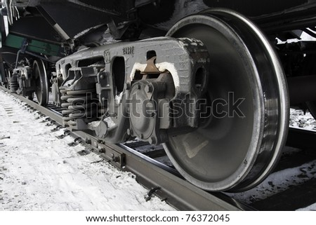 Railway wheels wagon. Behind the wheel. - stock photo
