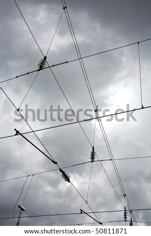 railway wire of the high tension line - stock photo