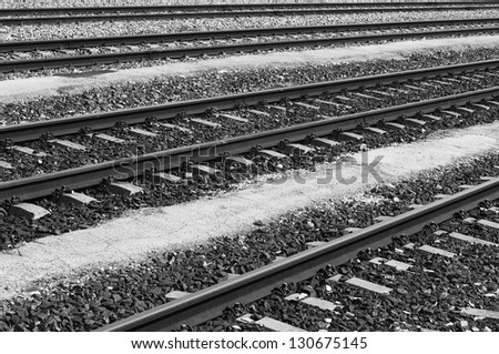 Railways sleepers and stones rails perspective black and white
