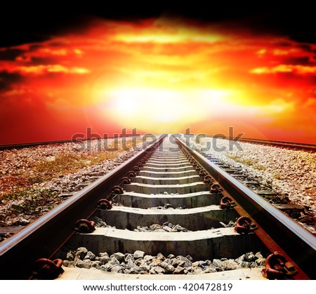Railways track in trains station against beautiful light