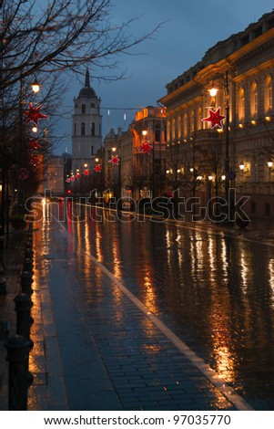 rain and reflection on pavement Gediminas Avenue in Vilnius