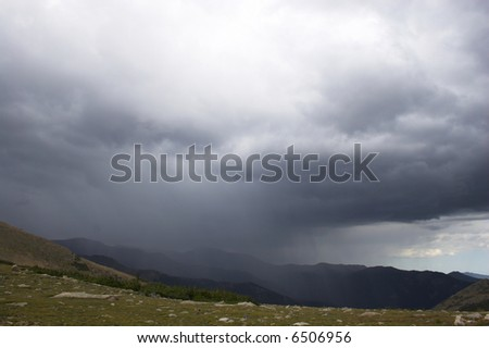 Rain and thunderclouds in the mountains tundra prairies forests of Cordeliers