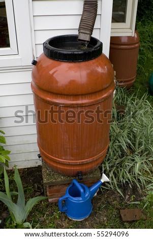 Rain barrel in a rain storm - stock photo