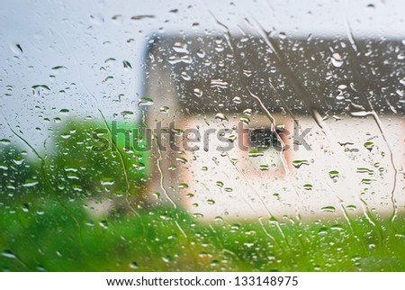 Rain behind a window, adverse weather conditions
