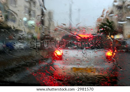 Rain behind glass of the car