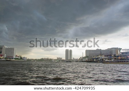 Rain Brewing One evening during the rainy season. Fluffy clouds rain is going to fall a storm is coming - stock photo