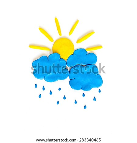 Rain cloud and sun made from modeling clay - stock photo