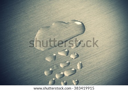 Rain cloud painted with water on the metal surface - stock photo