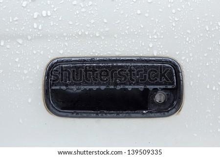 rain drop on car door handle - stock photo