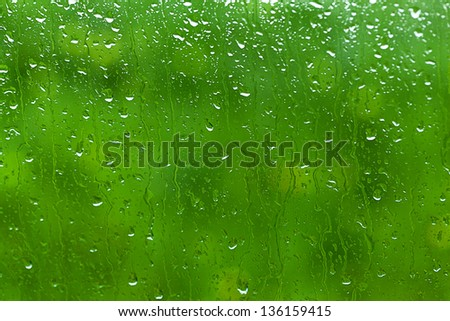 Rain drop through car window - stock photo