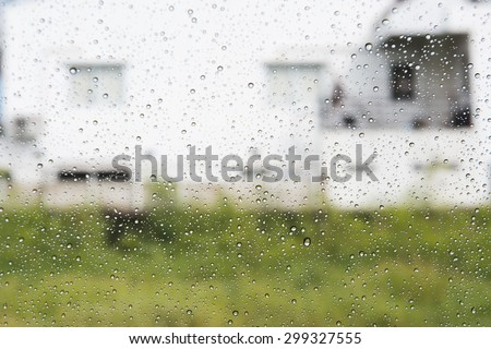 Rain drop through car window. - stock photo