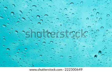 rain drop with blue background - stock photo