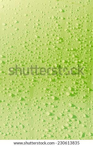 Rain droplets on green surface metal - stock photo