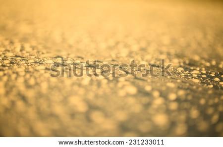 Rain droplets on yellow surface metal - stock photo