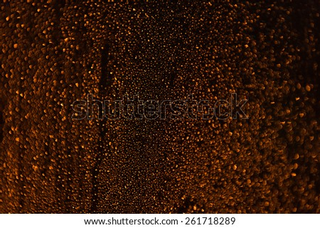 Rain droplets running down a window, abstract backlight background - stock photo