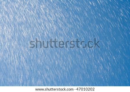 rain drops against blue sky - stock photo