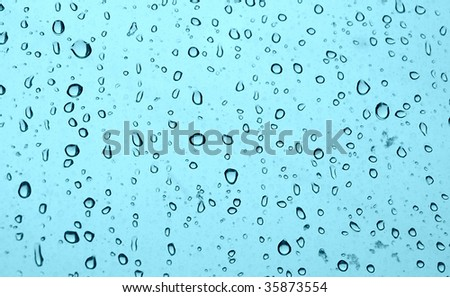 Rain drops and melting snow closeup background