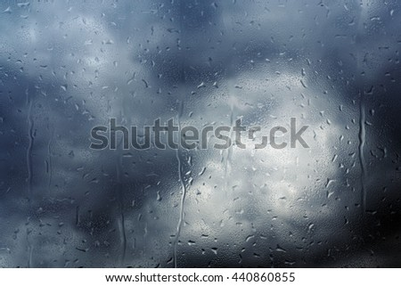 rain drops coming from very dark clouds on a window (3d illustration) - stock photo